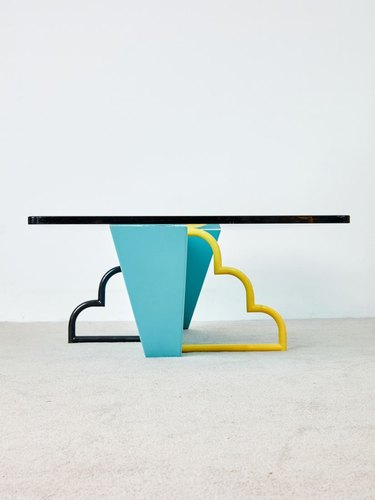 table with cloud legs in black and yellow with blue leg in middle