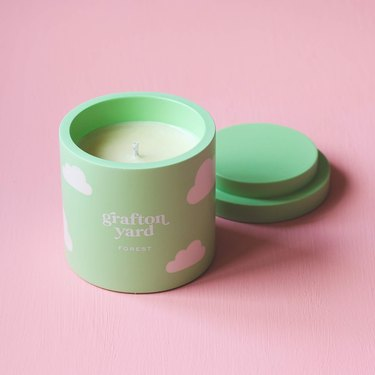 green candle with cloud pattern