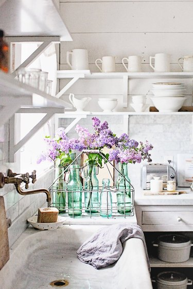 white french country style kitchen with open shelves