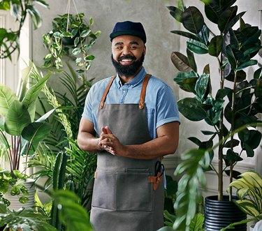 Hilton Carter standing near plants