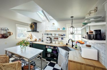 Small kitchen with skylight, checker tile floors.