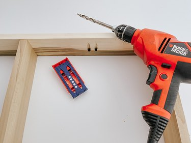 Drill down into the jig to create pocket holes for screws.