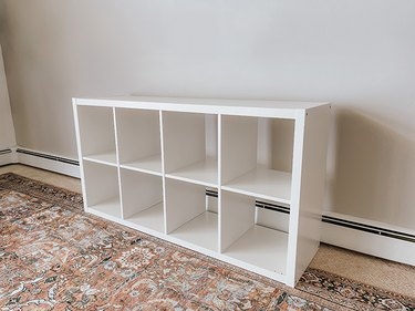 Assemble the IKEA Kallax shelf.