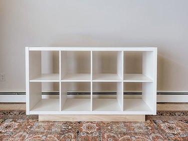 Flip the Kallax shelf right-side-up.