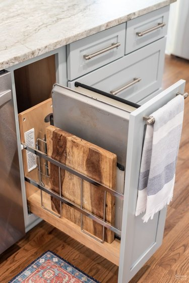 pull out cabinet in light blue kitchen island