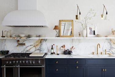 kitchen with marble countertops and integrated sink with blue cabinets