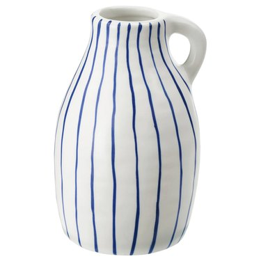 white and blue striped vase with handle