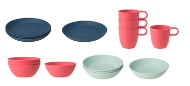 various iKEA plates in dark blue, red-ish, and light blue colors