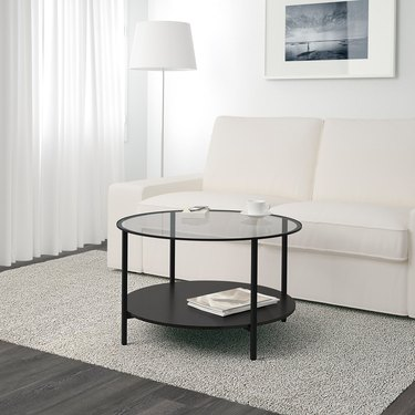round two tiered coffee table with glass top