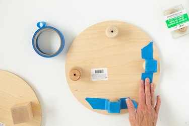 Add painter's tape to DIY wood circle plant riser