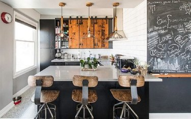 Small industrial kitchen with wooden bar stools
