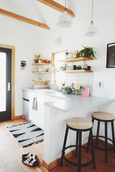 White kitchen with bar stools by Magic Dream Life