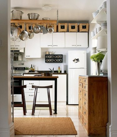 White kitchen with storage above the cabinets by One Kings Lane