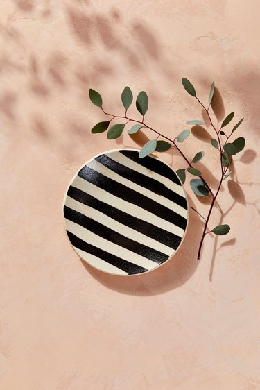 black and white striped tray dish with sprig nearby