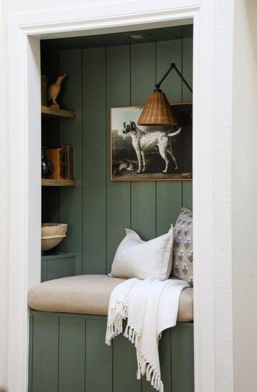 green shiplap wall in reading nook