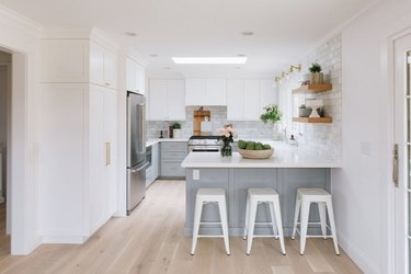 small kitchen layout idea with two tone cabinets and open shelving