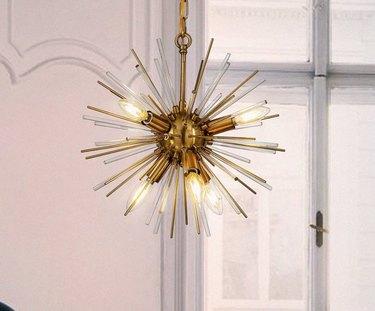 Sputnik chandelier in brass finish.