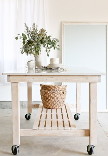 rolling wood kitchen island with bottom shelf for baskets