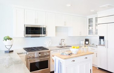 white coastal kitchen with freestanding island