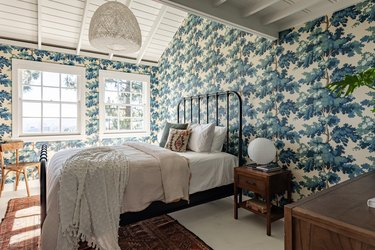 bedroom with blue printed wallpaper