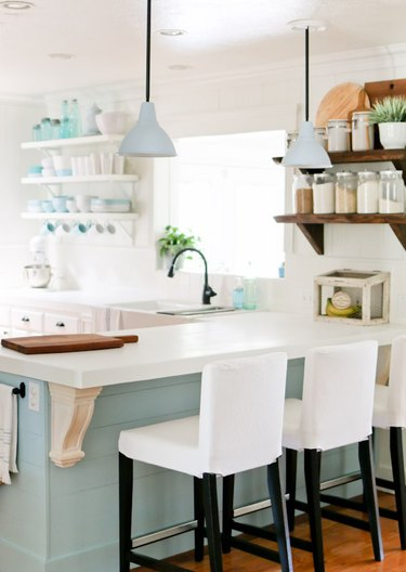 DIY solid surface kitchen countertops with blue green cabinets