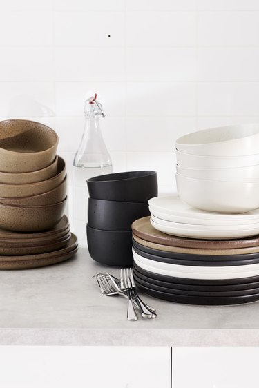 plates and bowls in neutral tones