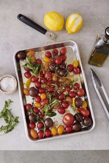 roasted tomatoes on baking sheet