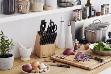 knife block and chopped vegetables