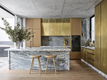 contemporary kitchen with brass cabinets