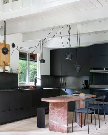 contemporary kitchen with suspension lighting