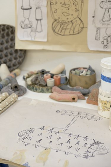 studio with drawings and tools