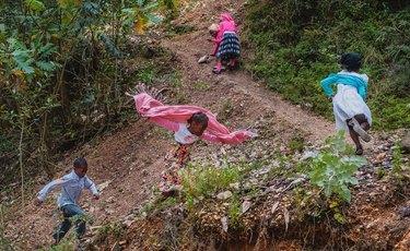 kids planning in woods