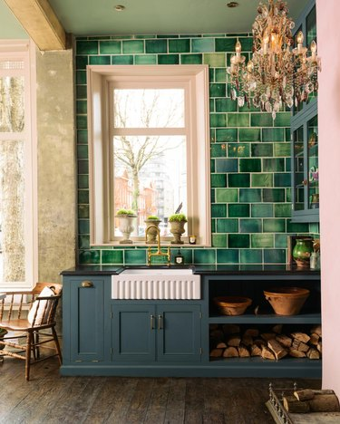 green and pink kitchen with ornate chandelier