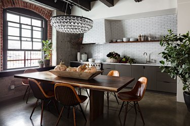 industrial kitchen with multi-tiered glass chandelier