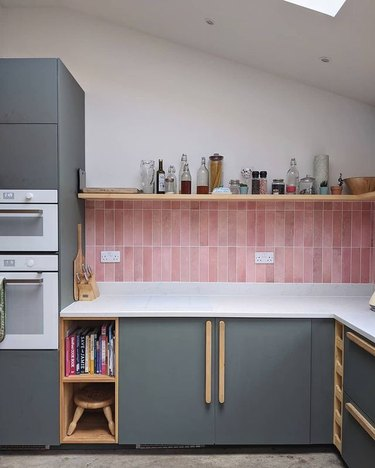 ikea cabinets with pink backsplash and custom handles