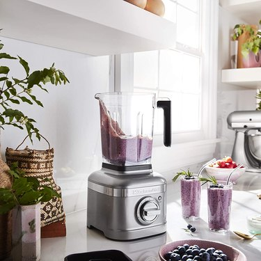 blender with purple smoothie on bright kitchen counter