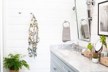 white shiplap paneling on bathroom walls