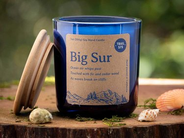 candle in blue container with brown label