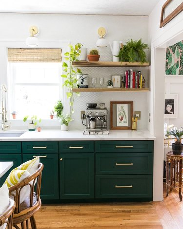 brass and white wall sconces in white and green boho kitchen
