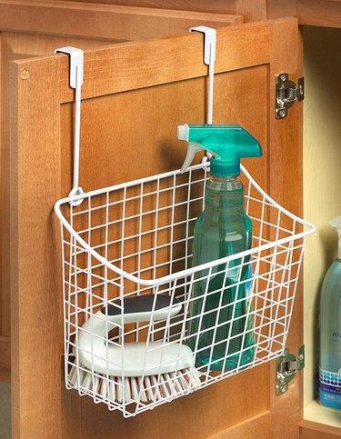 white metal over the cabinet door basket
