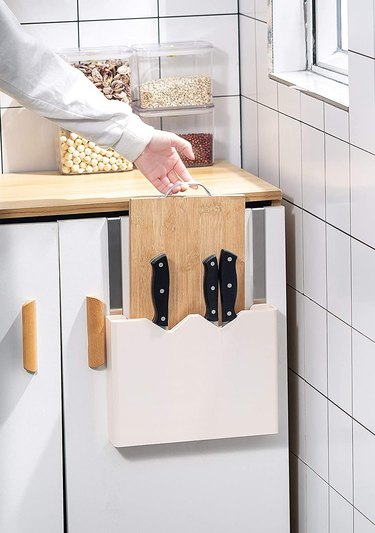 over the cabinet door cutting board holder