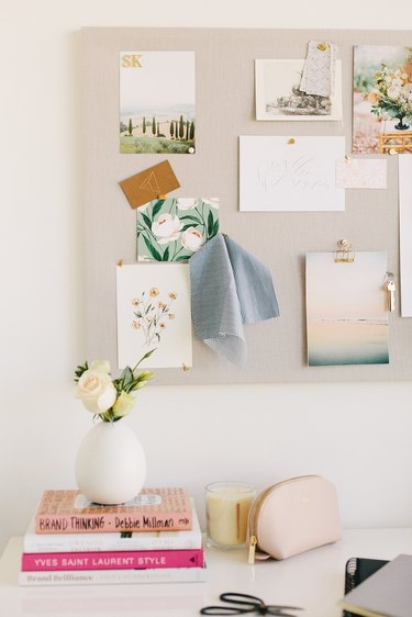 fabric pinboard with pieces of inspiration in white home office