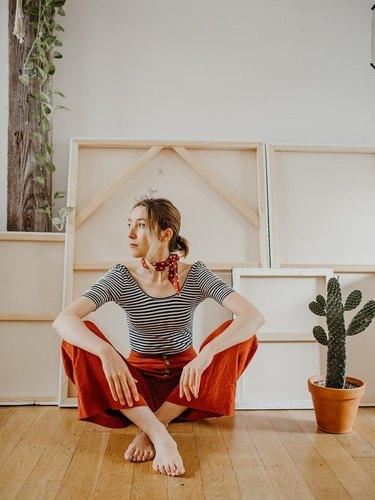 Sofia Shu sitting on floor of art studio