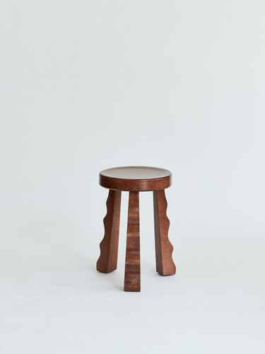 small stool with wavy legs