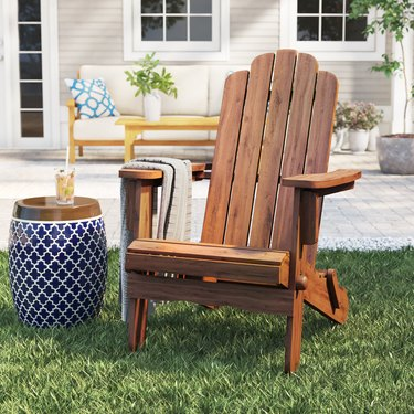 wood adirondack chair on lawn