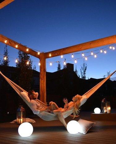 pergola hammock with string lights