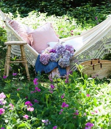 garden hammock decor with hydrangeas