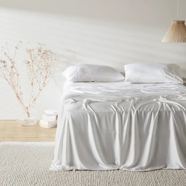 Ettitude sheets on bed