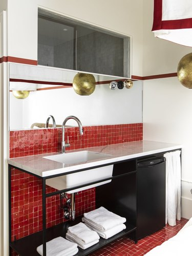 red color blocked bathroom with gold accents