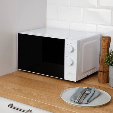 small white microwave on counter